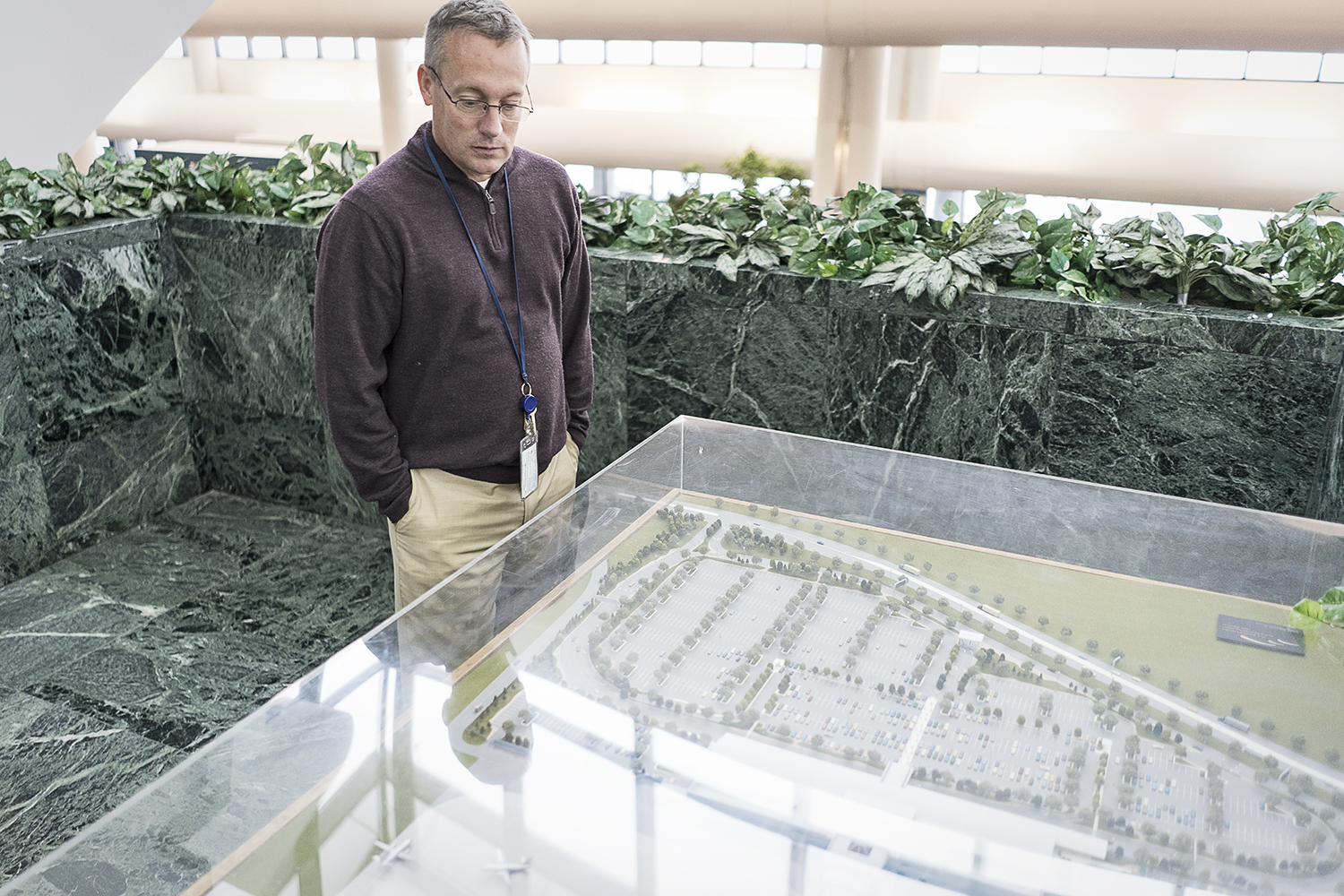 Bishop International Airport Director Craig Williams, 48, of Fenton, looks at the scale model of Bishop as it was envisioned in the early 1990s. Remarkably, the airport has very little variation than the original proposed model.