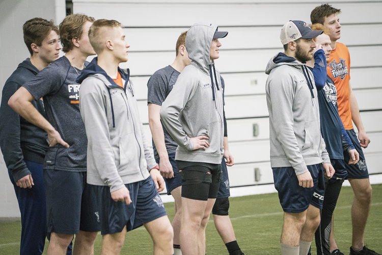Flint, MI - Tuesday, January 30, 2018: Flint Firebirds' Center Ty Dellandrea (center), 17, stands amongst his teammates during post-practice recovery at the Dort Federal Event Center.