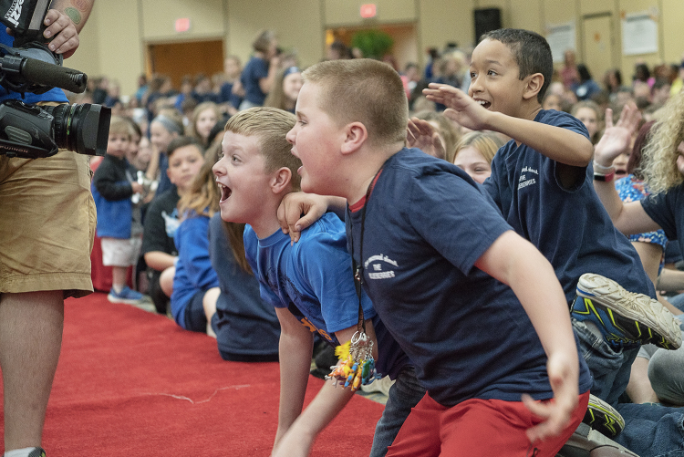 Flint, MI - Friday, May 4, 2018: Enthusiastic Blueberry Ambassadors cheer and jeer at the camera before the show begins at the 5th Annual Blueberry Ambassador Party at the Riverfront Banquet Center downtown.