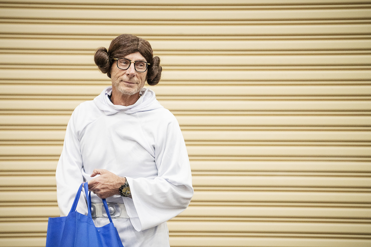 Flint, MI - Friday, May 4, 2018: Fenton Twp. Resident and Blueberry Founder Phil Shaltz, 69, looks across the crowd of Blueberry Ambassadors while dressed as Princess Leia from Star Wars before handing out blueberry-replica stress balls during the 5t