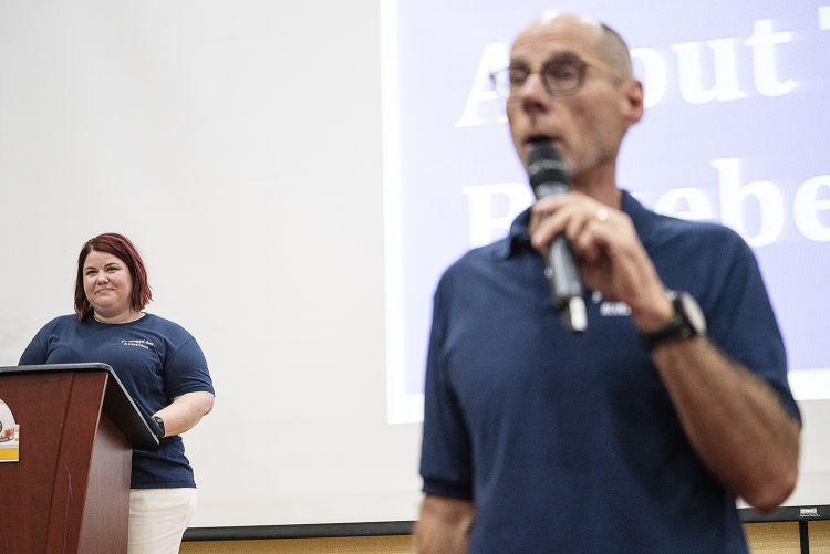 Flint, MI - Friday, May 4, 2018: FlintSide publisher and Flint resident Marjory Raymer, 44 (left) watches as Blueberry Founder and Fenton Twp. resident Phil Shaltz, 69, speaks to the Blueberry Ambassadors during the 5th Annual Blueberry Ambassador Aw