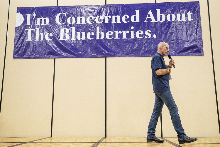 Flint, MI - Friday, May 4, 2018: Fenton Twp. resident Phil Shaltz, 69, Blueberry Founder, paces on the stage as he speaks to the Blueberry Ambassadors during the 5th Annual Blueberry Ambassador Awards Party at the Riverfront Banquet Center downtown.