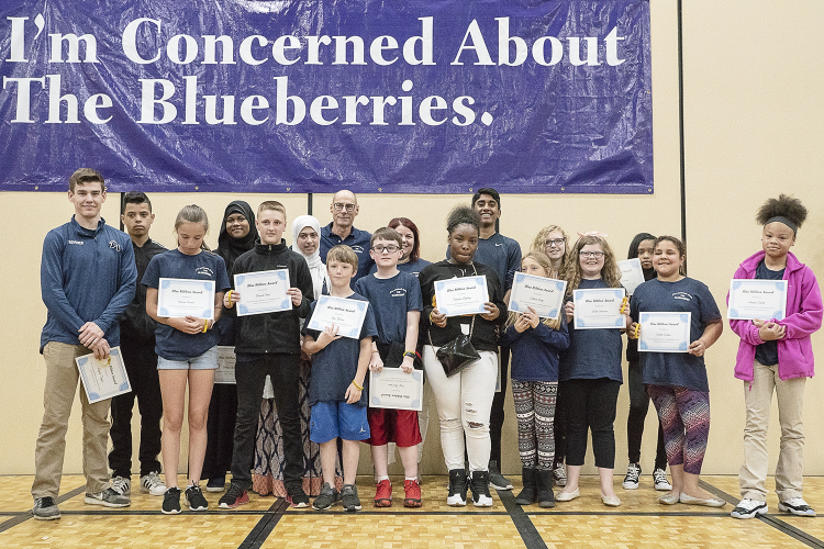Flint, MI - Friday, May 4, 2018: Blueberry Ambassador Blue Ribbon Award recipients stand on stage for a photograph during the 5th Annual Blueberry Ambassador Awards Party at the Riverfront Banquet Center downtown.