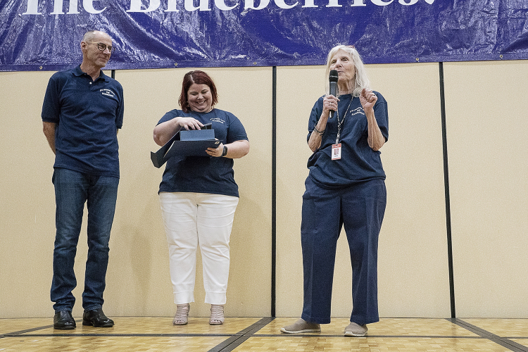 Flint, MI - Friday, May 4, 2018: Grand Blanc Perry Innovation Center teacher Vickie Weiss (right) speaks to the Blueberry Ambassadors after receiving the Blueberry Ambassador Inspirational Teacher Award during the 5th Annual Blueberry Ambassador Awar