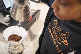 Flint, MI - Friday, June 15, 2018: Barista Cha'Quia Jones, 20, from Flint, prepares a cup of pour over coffee at Chill Coffee Cafe.