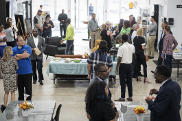 Flint, MI - Thursday, June 22, 2018: Attendees gather in the lobby at The Ferris Wheel in Downtown Flint for the move-in party.