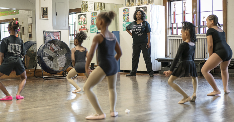 In a small second floor studio in the Berston Field House in Flint, Sheila Miller-Graham (center) watches a young ballet class practice in front of the mirror. At  Creative Expressions Dance Studio, Miller-Graham works to instill a sense of confidenc