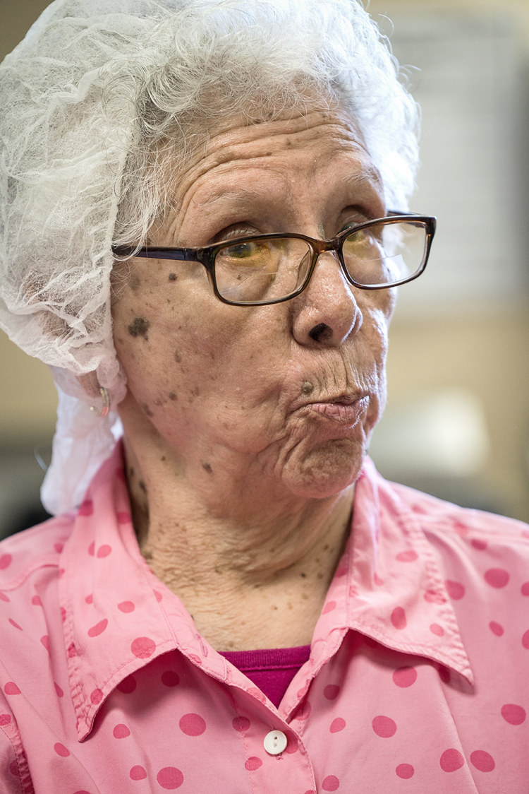 Connie Aguilar, 81, of Flint, reacts to the conversation swirling around the Tortilla Factory.