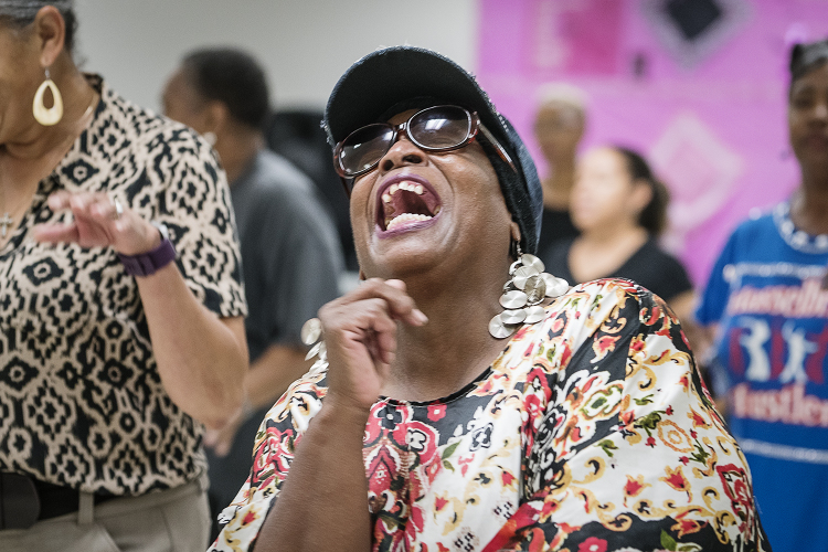 Flint resident Ethel Brown laughs as she dances with the other Hasselbring Hustlers at the Hasselbring Senior Community Center. Over the past three years, Brown has seen positive results from dancing, including weight loss and better mobility.
