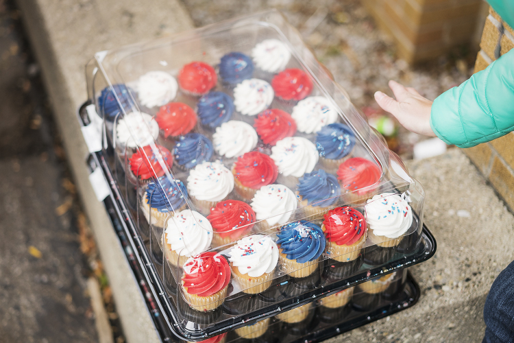 Dozens of red, white and blue cupcakes wait to be loaded onto the trailer before departing Riverside Tabernacle Church to the Flint Community Cookout. The volunteers bring various snacks and food for the community, all paid for by fundraisers hosted