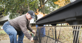 Steven Moore, 52, of Davison cleans the grate of the large grill at the Flint Community Cookout at the Riverbank Park. Moore, a retired police officer, enjoys being able to connect with the community in a positive way, which wasn't always the case wh