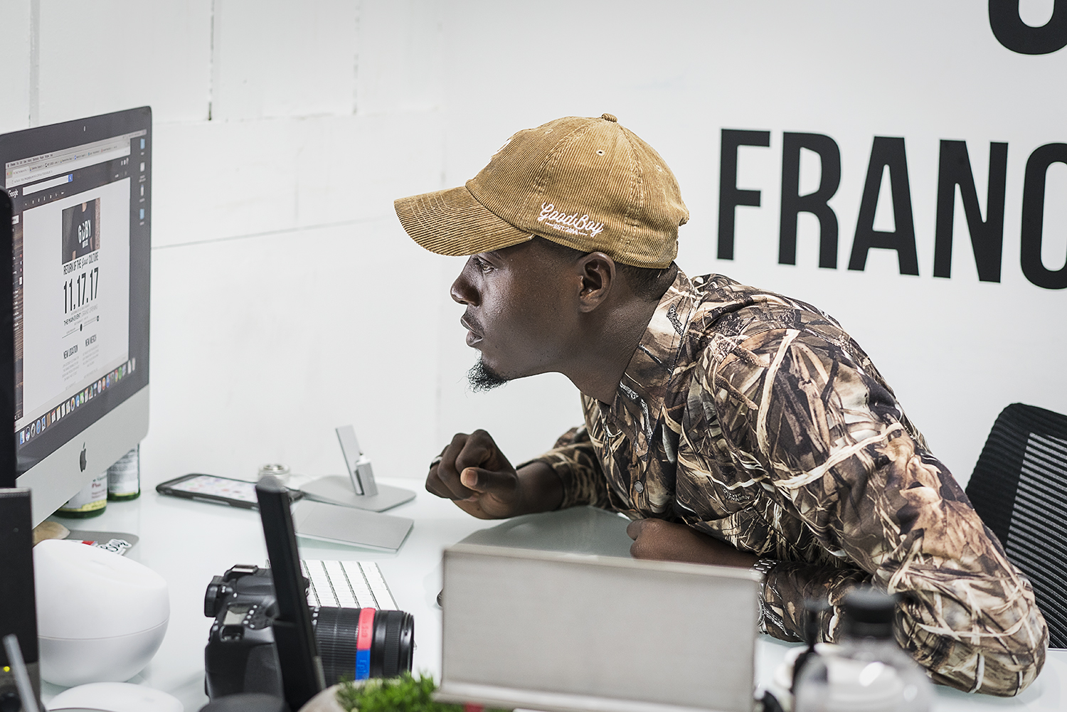 Operations Manager for GoodBoy Clothing Mark Chatman, 27, of Flint, proofreads the website, ensuring that it is ready for the launch of the new storefront in downtown Flint.