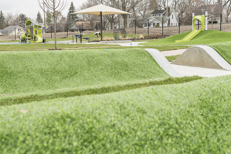 Flint, MI - Tuesday, November 21, 2017: Small rolling hills are just part of a large playscape outside of four classrooms at the new Educare Center in Flint.