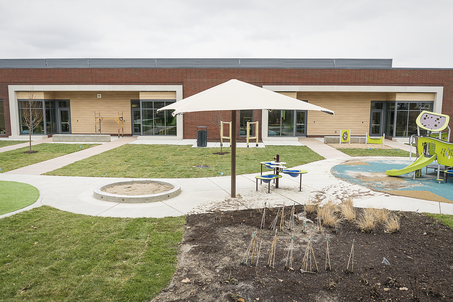 Flint, MI - Tuesday, November 21, 2017: New landscaping, activity centers and playscapes are being installed outside of the classrooms at the new Educare Center in Flint.