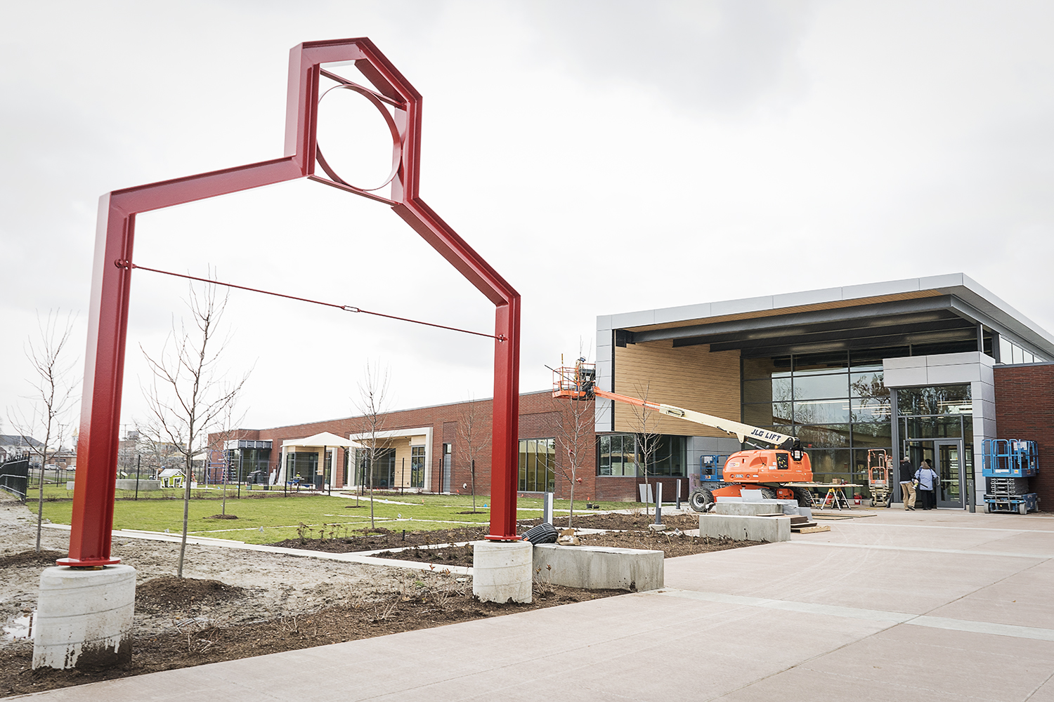 Flint, MI - Tuesday, November 21, 2017: Workers put the finishing touches on the entryway of the new Educare Center in Flint.