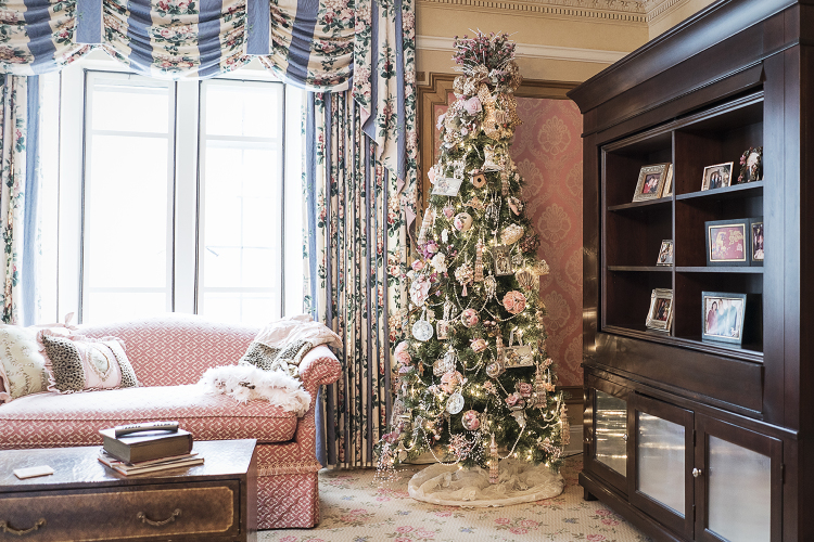 A Victorian-style Christmas tree stands in the corner of the Heddy's bedroom in their home.
