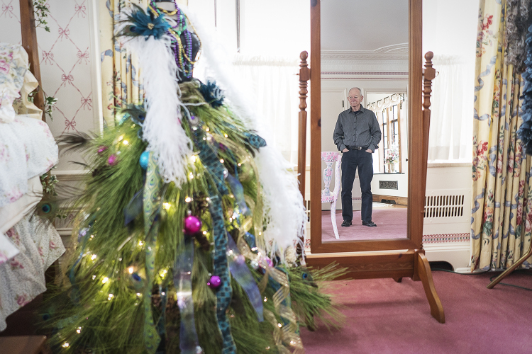 Steve Heddy looks at a Christmas tree he and his wife Rosanne created from a mannequin bodice in their home.