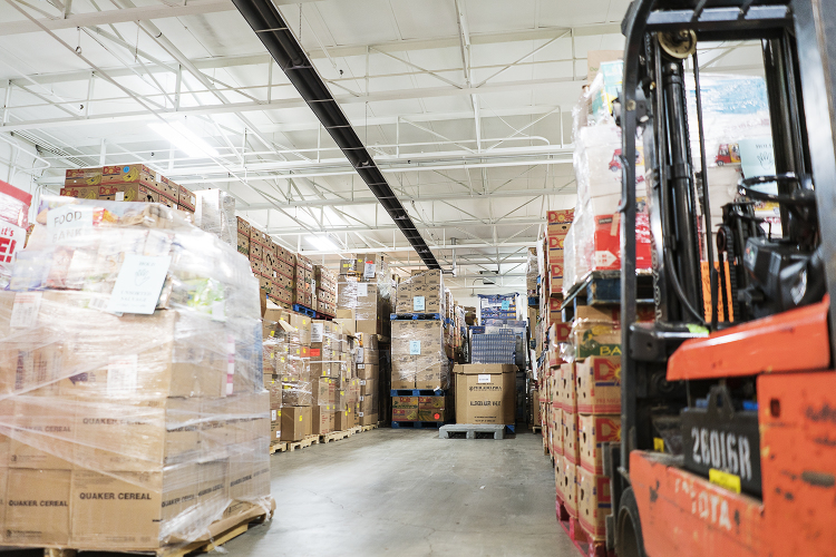 Pallets and pallets full of food wait to be inspected, sorted and shipped in the warehouse of the Food Bank of Eastern Michigan.