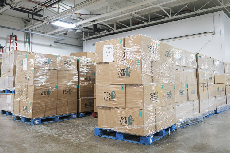 Large boxes full of food for holiday meals await transport at the Food Bank of Eastern Michigan.