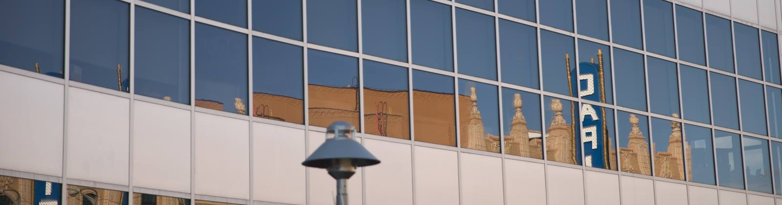 The Capitol Theatre sign is reflected in the windows of the Wade Trim Building in downtown Flint. The theatre is undergoing a massive $37 million renovation.