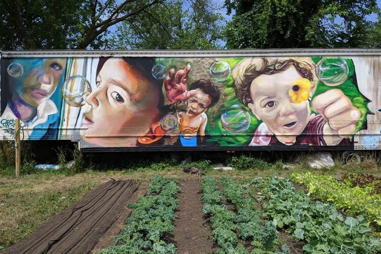 Isiah Lattimore-Balicki created this mural at 1605 Jane Avenue, adding even more life to the garden project there.