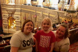 Isla Hayes with UM-Flint ECDC teachers Jen Cozart (left) and Jessica Matusz during Double Dare Live at the Fox Theatre in Detroit.