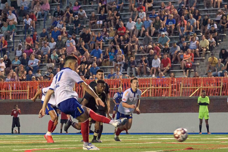 Yuri Farkas delivers the game-winning penalty kick July 27, 2019, to carry the Bucks to the national championship.