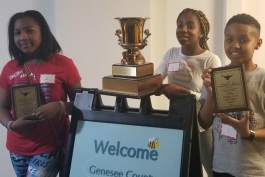 Winners of the fifth-eighth grade championship are first place Aurora Akinpeloye from Grand Blanc East Middle School, followed by Joshua Tewolde from Grand Blanc West Middle School and Kamaria Carter-Ryan from Woodland Park Academy.