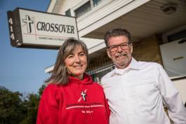 Denise Diller and Craig Leavitt pose outside Crossover Ministries current building at Grand Traverse and Court streets.