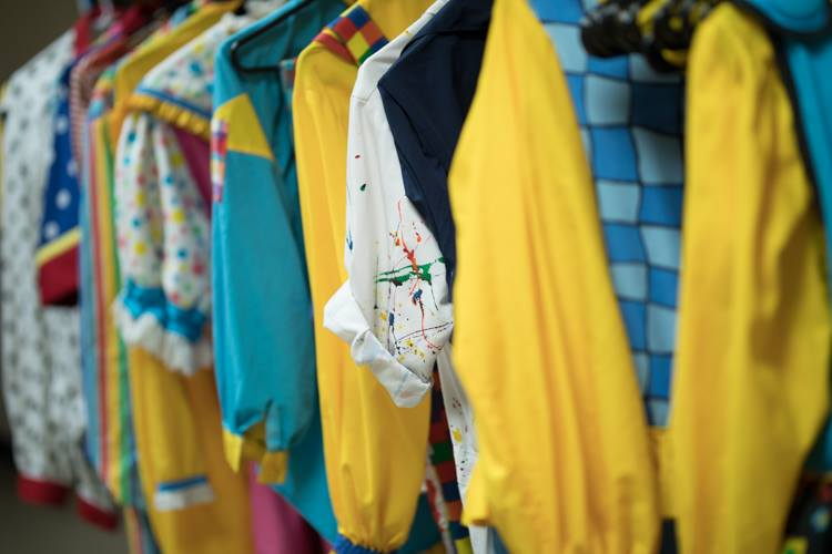 The costumes are lined up and ready for the 11-member clown troop known as the Mott Campus Clowns, which delivers an anti-bullying message in its performances.