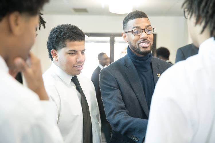 Isaiah Oliver gives last minute encouragement to the young men of the Alpha Esquires before their Martin Luther King Day performance.