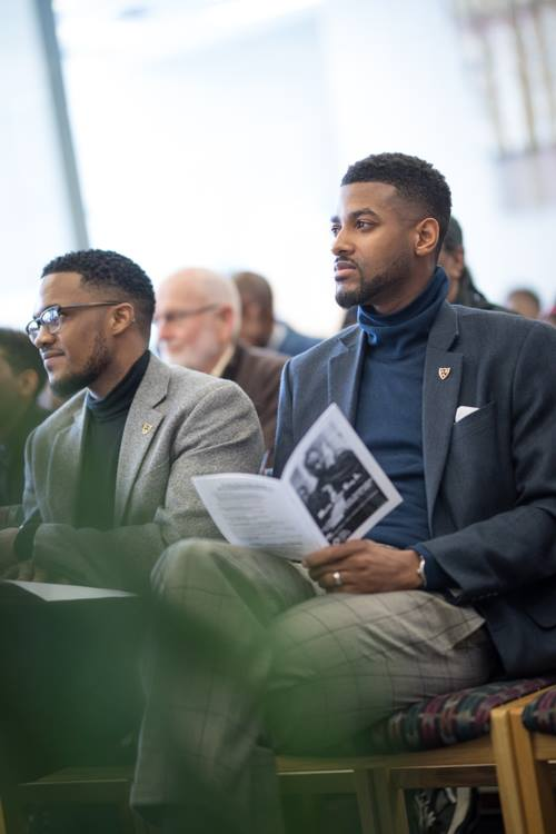 Isaiah Oliver, president of the Community Foundation sits with Ja'Nel Jamerson, executive director of the Flint and Genesee Literacy Network, at the Flint Public Library.