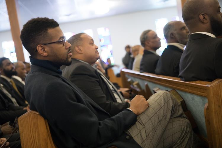 Isaiah Oliver sits with other members of the Alpha Phi Alpha fraternity at the MLK Day Youth Tribute, which includes performances by the Alpha Esquires.