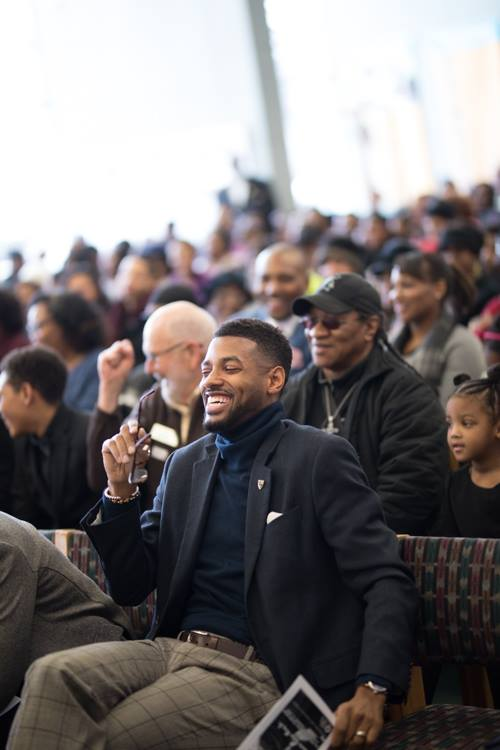 Isaiah Oliver laughs at a joke from U.S. Rep. Dan Kildee during the MLK Day celebration at Flint Public Library.