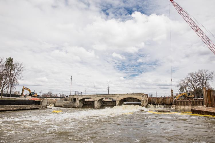 Work continues on the removal of the Hamilton Dam, part of a project designed to revive the Flint River downtown.