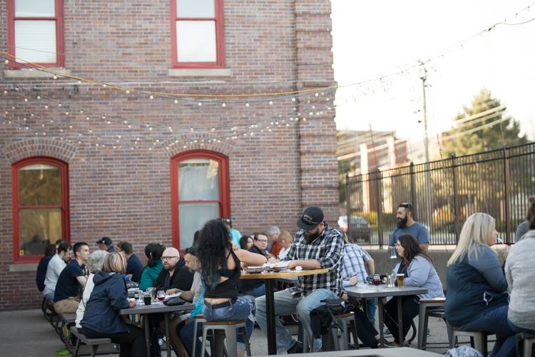 A crowd fills the patio on a recent trivia night at Tenacity Brewing, which like other downtown Flint bars is pairing its standard taps with unique events.