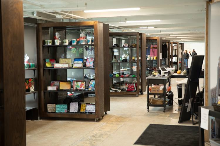 The Dryden Building Retail space sells a variety of goods including mugs, T-shirts, art, and eyeglasses from 13 vendors.