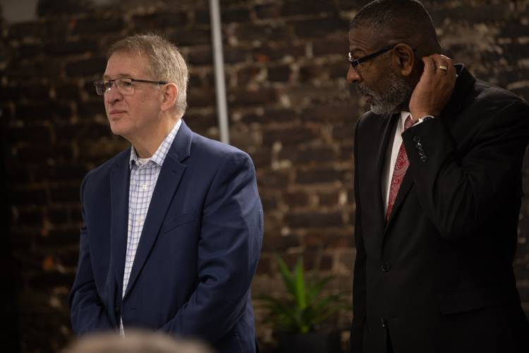 Businessman Phil Hagerman and Flint City Administrator Steve Branch look on during the announcement on Wednesday of the new team name.