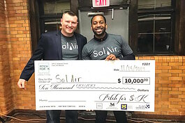 Jonathan Quarles holding his first place $10,000 win from November 2019's Pitch for $K event.
