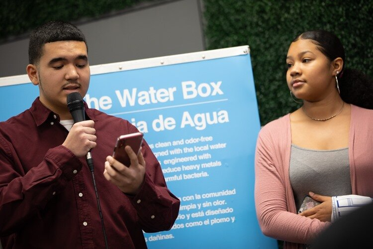 Latinx Leadership Academy youth Tomás Tello, 16, beside Suamy Gutiérrez, 17, recites a poem to residents during the public showing at the Latinx Technology and Community Center on Monday, Dec. 2.