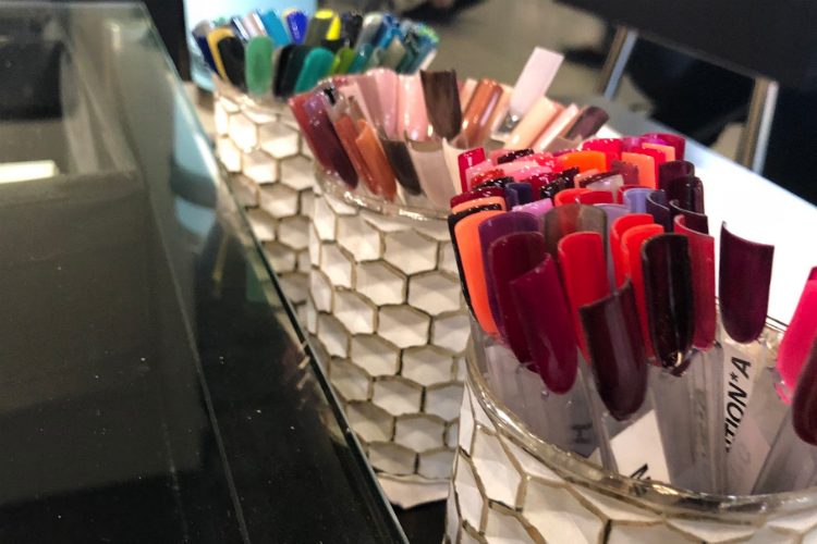 The shellac nail color choices on display at Eight Ten Nail Bar, which opened in May 2018.