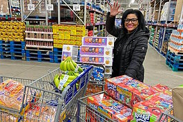 Deria Brown, owner of Glam Boutique, shopping for donations for her free-lunch initiative on Saturday, March 14.