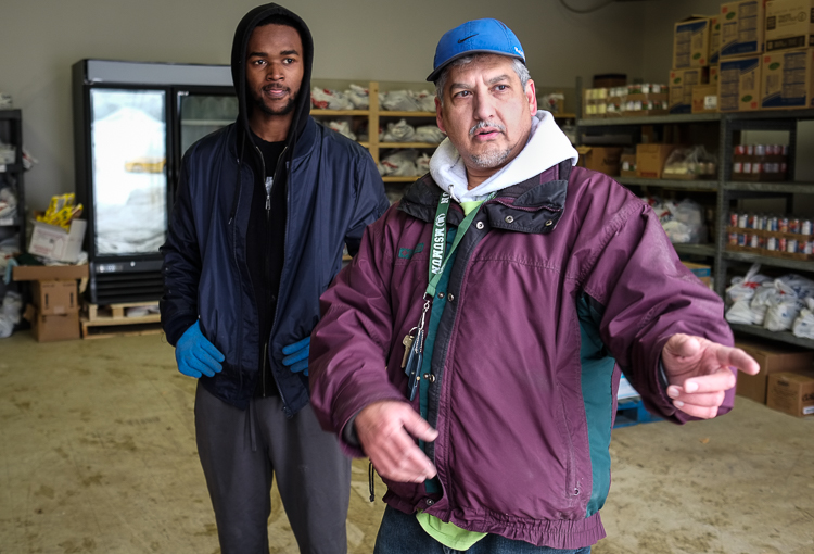 Adil Mohammed (right) and employee Tahj Moore-Parnell help as Food Bank of Easterrn Michigan delivers more food to the Flint Muslim Food Pantry. Located in the Insight building on South Saginaw Street, the pantry serves the whole community.