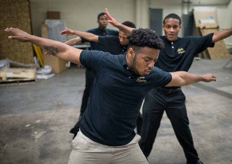 Gianni Love, 19, of Flint Township, rehearses a step-dance routine with other members of the Alpha Esquires at the Mott Community College Workforce Center on North Saginaw Street in Flint earlier this month.