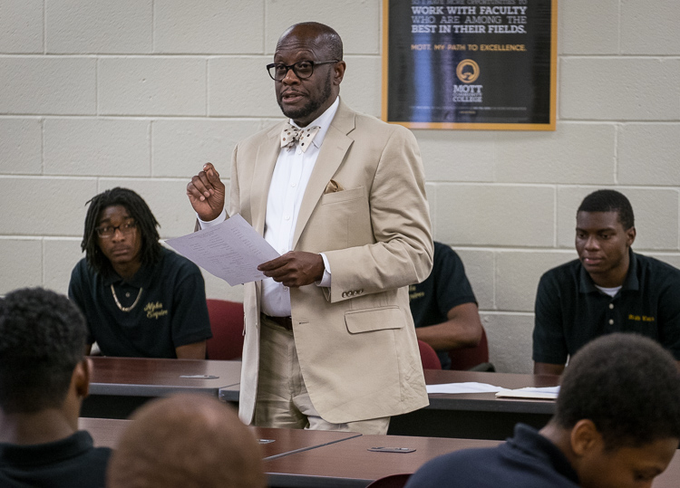 Advisor Sam Wells of Flint Township talks to the young men of the Alpha Esquires during a meeting.