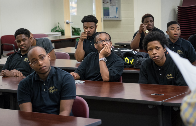 The young men of Alpha Esquires listen during the group's weekly meeting at Mott Community College Workforce Center on North Saginaw Street in Flint.