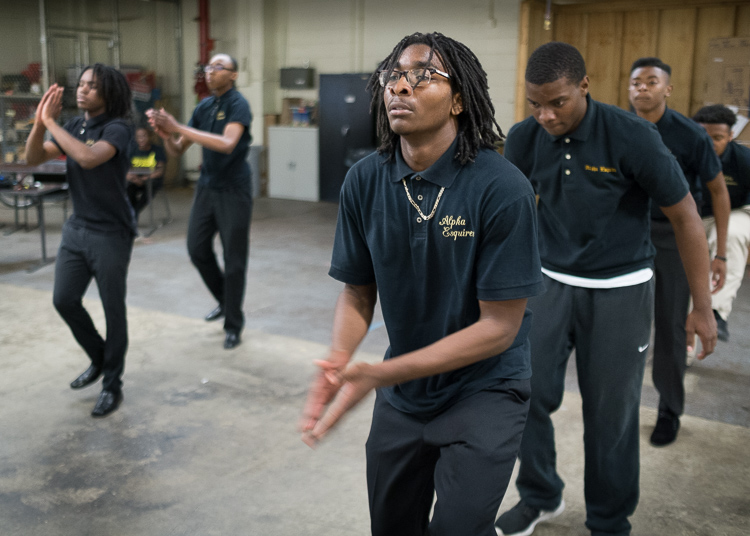 Eric Owens II, 16, of Flint, rehearses a step-dance routine with other members of the Flint Alpha Esquires.