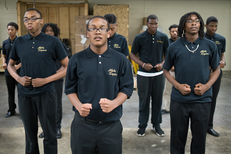 Isaiah Hill, 15, of Flint, rehearses a step-dance routine with  other members of the Alpha Esquires.