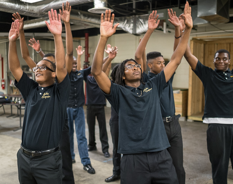 Isaiah Hill, 15, of Flint, (left) and Eric Owens II, 16, of Flint, rehearse a step-dance routine with  other members of the Alpha Esquires, which are celebrating their 20th anniversary.