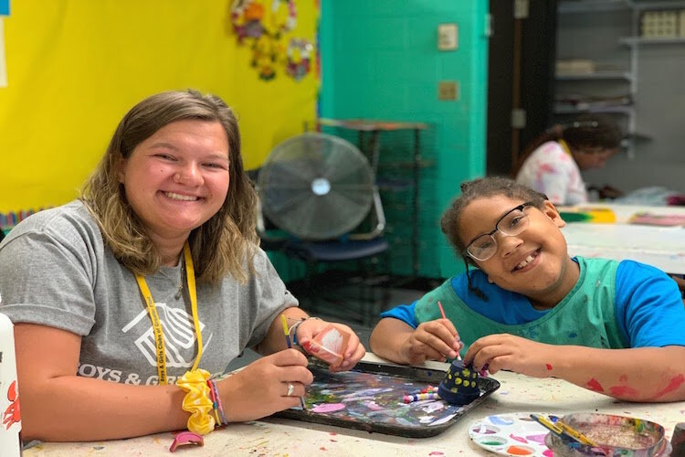 Boys and Girls Club members express themselves with paint in the Art Room during the summer of 2019.